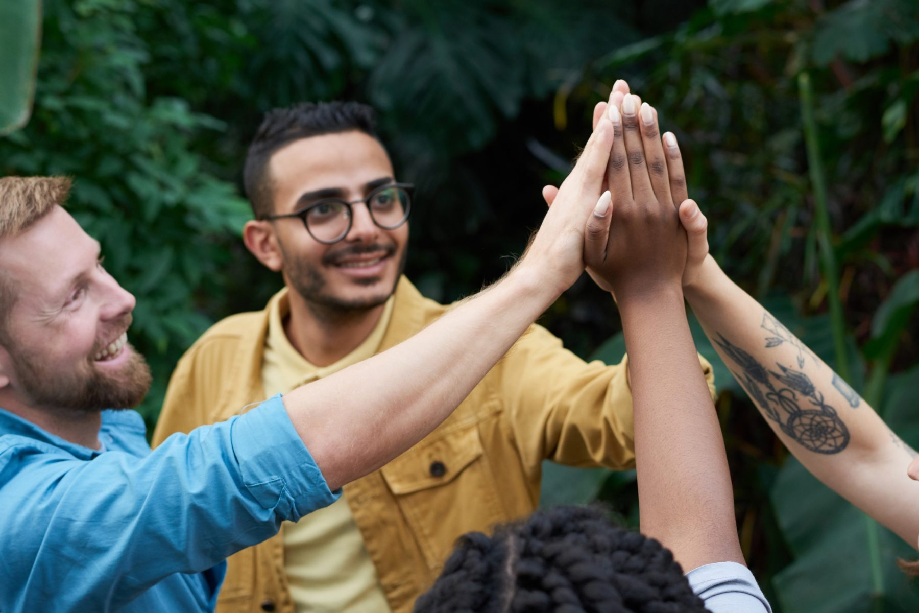 Group of people engaging through joining hands